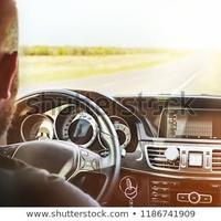 driving-car-man-beard-sitting-450w-1186741909