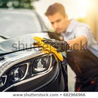 car-detailing-man-holds-microfiber-450w-682966966