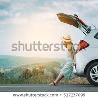 woman-traveler-sitting-on-hatchback-450w-517237099